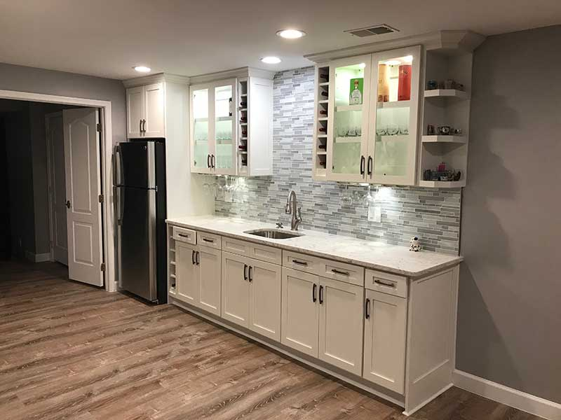 Entertainment Room – Bar area, Stairs, & Bathroom